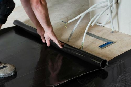 Isolant acoustique pour parquet flottant entre étages sur plancher bois